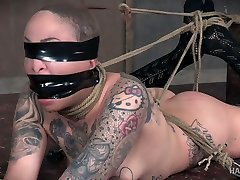 Tattooed bondage whore Leigh Raven is fucked and punished by one kinky dude