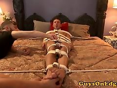 Male sub restrained to bed for jerking cumshot