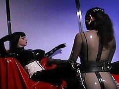 Anastasia Pierce Enjoys Rubber Slave