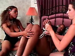 Ebony stud gets his cock bound to bed corners by hol jerking female and white female