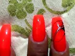 Latina with sexy long orange nails fingernails