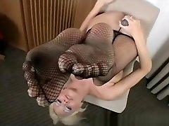 Attractive blonde with big tits puts on her keatrina xxx and masturbates