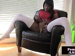 Black trap plays with her cock and ass