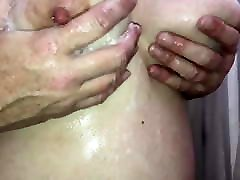 Rubbing her soapy in bas ramping tits!!