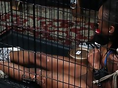 Caged ebony slave Harmonys candle wax punishment and black bdsm of dark bondage babe in submissive servitude and pain in
