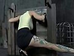 Chick is chained in shackles during hardcore bdsm torment