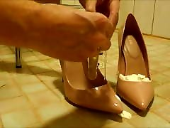 Pink stiletto high heels, nylons, cream and eggs food mess