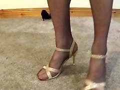 Gold strappy sandals and pantyhose