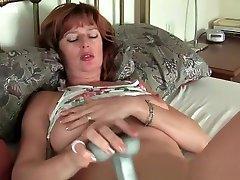 sanilion xxxcxx redheaded mom masturbates with sex toys