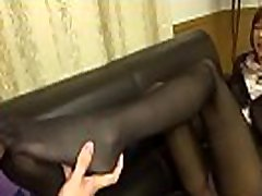 Japanese Milf gives dream footjob in pantyhose