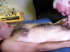 Silver tattooed daddy fucks young hairy guy
