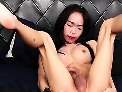 Busty french amateur blonde tugs on her curved cock