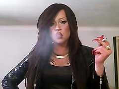 Gorgeous porny orn with long red nails smokes