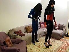Alexandra and Karyn playing in latex