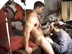 Muscle Bear Construction Worker gets blowjob from photographer