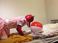 Rubber fox maid plays with beach ball