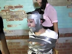 MILF Taped And Multi Gagged