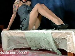 Petite tattooed Latina shows off her pantyhosed legs