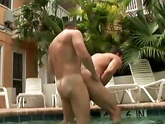 Two short porn mobile hunks are fucking in the swimming pool