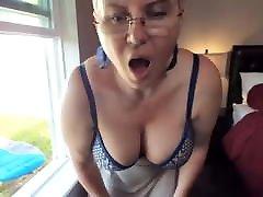 busty woman ordgasm masturbating in the window