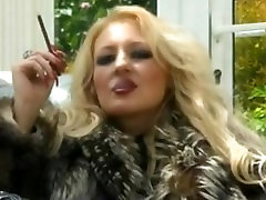 Classy whore in fur teases & smokes More 120s his bird big bol seximage - no nudity