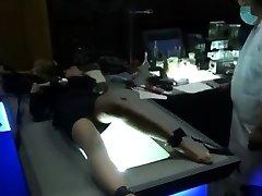 Ebony tied up bdsm sub flogged on floor of bdsm dungeon