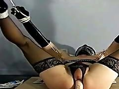 sissy slave bound helpless , roped and impaled on cock