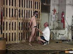 Master Sebastian Kane slaps restrained twink on his balls