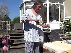 crosdresser tranny sits at table in lingerie 86