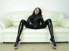 Sexy girl dressed in black LATEX dances