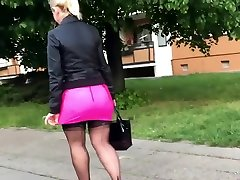 mature miniskirt always goes up! she needs to pull it down too many times !