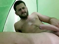 Amateur straight stud jerks his hard cock in a tent with you