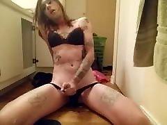 Sissy tranny rides her dildo while stroking