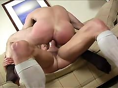 macho men fucking on a couch