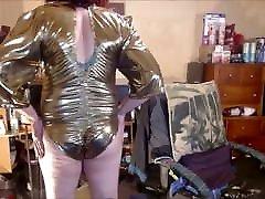 Tranny model in vintage gold lame&039; bodysuit.