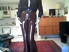 posing in brown rubber slacks