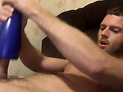 fit hairy guy wanks with sex toy then eats his load