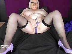 Mature huge tits in the bedroom