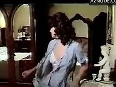 F. Benussi in 1977 movie undressed white satin bra and less
