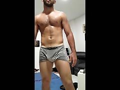 Musky alpha male dripping sweat post workout - fit muscle