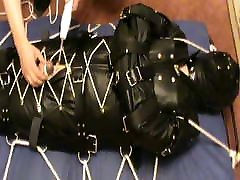 In a leather insane sack