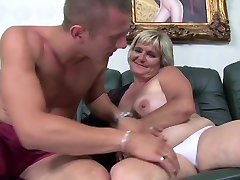 Blonde 50 making fucking pleases young man on the sofa
