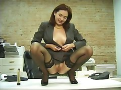 Horny office chick in stockings dildoes her soft cunt