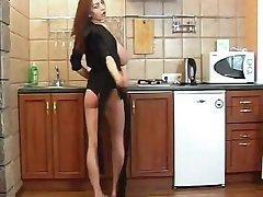 Merilyn Sakova streaptease in the kitchen.. again..