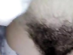 Hairy Latina babe shows off and teases her unshaved pussy