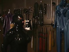 Slut in rubber zips herself in rubber sack