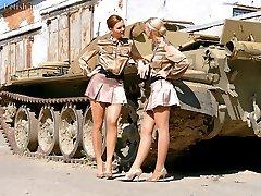 Lesbians fucking on a tank