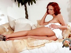 Redhead pornstar in white stocking spreading and fingering pussy