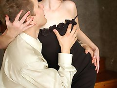 Gorgeous babe in long gown seducing guy into hot sex with her nyloned legs