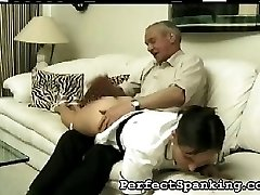 She tries to cover her round ass, but her stepfather pulls her hand away and lands another hard...